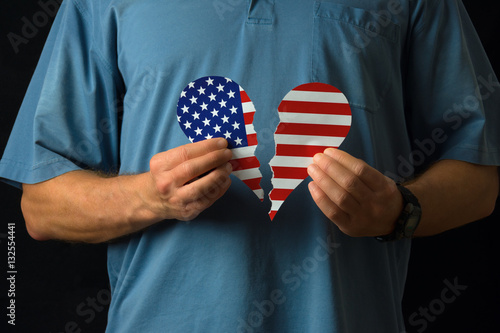 Photo  United States of America citizen torn broken heart over politics, political divi