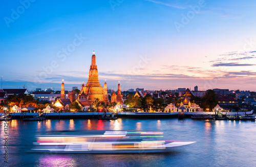 Foto op Canvas Bangkok The boat was sailing in Chao Phraya River, background Wat Arun at sunset time ,Bangkok, Thailand. The Temple of Dawn