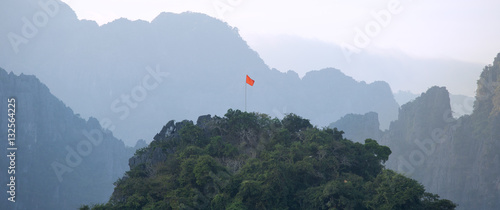 Papiers peints Colline Red flag on the top of mountain,Laos,Vang Vieng territory