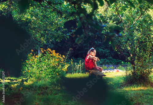 Poster Feeën en elfen Little Girl Outdoors. Beautiful sad girl dreaming in the park