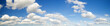 Leinwandbild Motiv puffy white clouds in the blue sky,panorama