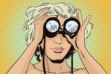 Girl Looks Through Binoculars. Her Hair Fluttering In The Wind.