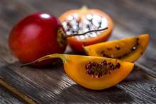 Fresh Fruit Tamarillo On Woode...