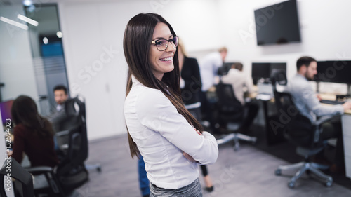 Businesswoman walking in office and smiling
