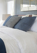 Dark color scheme pillows on bed with comfy bedding