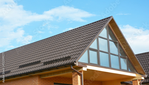 Building Modern House Construction With Metal Roof, Rain Gutter System