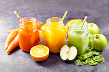 Fototapeta na wymiar Fresh juice and smoothies with fruits and vegetables