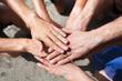 volunteering or teamwork concept, team gathering hands together