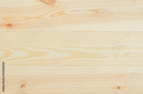 Photo Stands Wood Fresh knotted pine wood planks background top view. Visible texture with natural patterns.