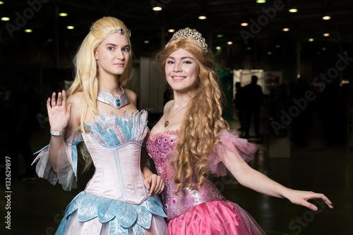 Fotografie, Obraz  Two young woman cosplayer wearing beautiful dresses posing