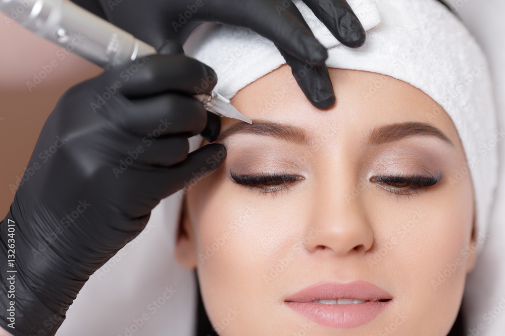 Fototapety, obrazy: Permanent makeup. Tattooing of eyebrows
