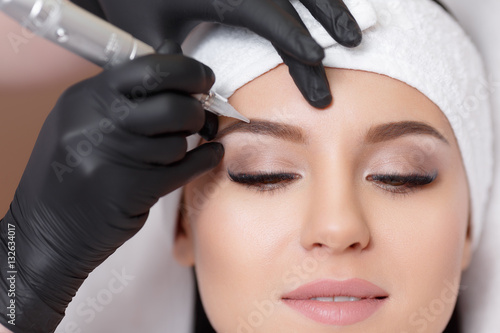 Obraz Permanent makeup. Tattooing of eyebrows - fototapety do salonu