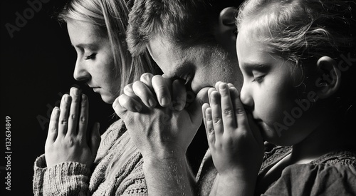 Fotografie, Obraz  Praying family. Man, woman and child.