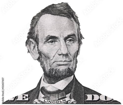 US president Abraham Abe Lincoln face portrait on USA 5 dollar bill closeup isolated, United States of America money close up. Wall mural