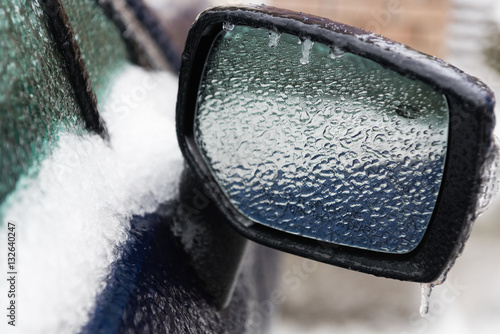 Fotografie, Obraz  Car's rear mirror in iced cold weather