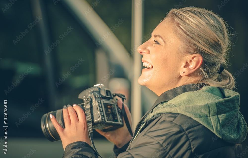 Fototapety, obrazy: Happy Female Photographer