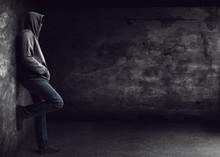Man Standing Alone At Night
