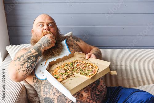 Fotografia Man eating pizza