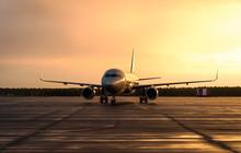 Airplane At Sunrise - Back Lit.