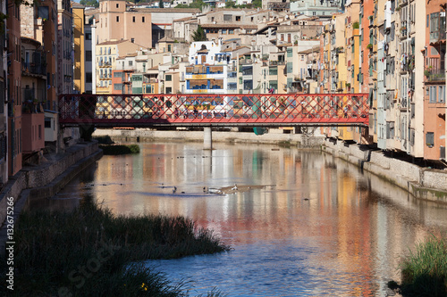 Photo  Houses and Eiffel Bridge in city of Girona in Spain