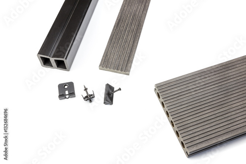 Photographie  Grey composite decking board with fastening material