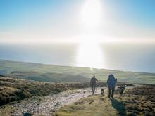 Family Enjoying Hiking On Black Combe In The Lake District, Overlooking The Irish Sea