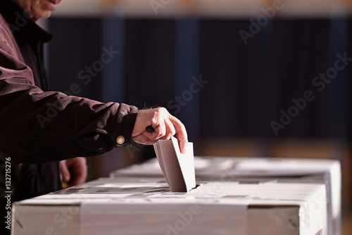 Fotografie, Obraz  Person casting vote into ballot box