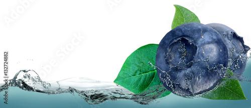 Blueberries on a background of splashing water. Wallpaper Mural