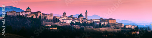 Cuadros en Lienzo Bergamo Alta old town colored af sunset's lights - Lombardy Italy