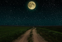 Beautiful Magic Night Sky With Fullmoon And Stars  Road Receding Into The Distance  Green Grass
