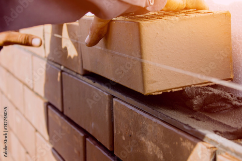 Foto Facing bricklaying construction work, manual labor