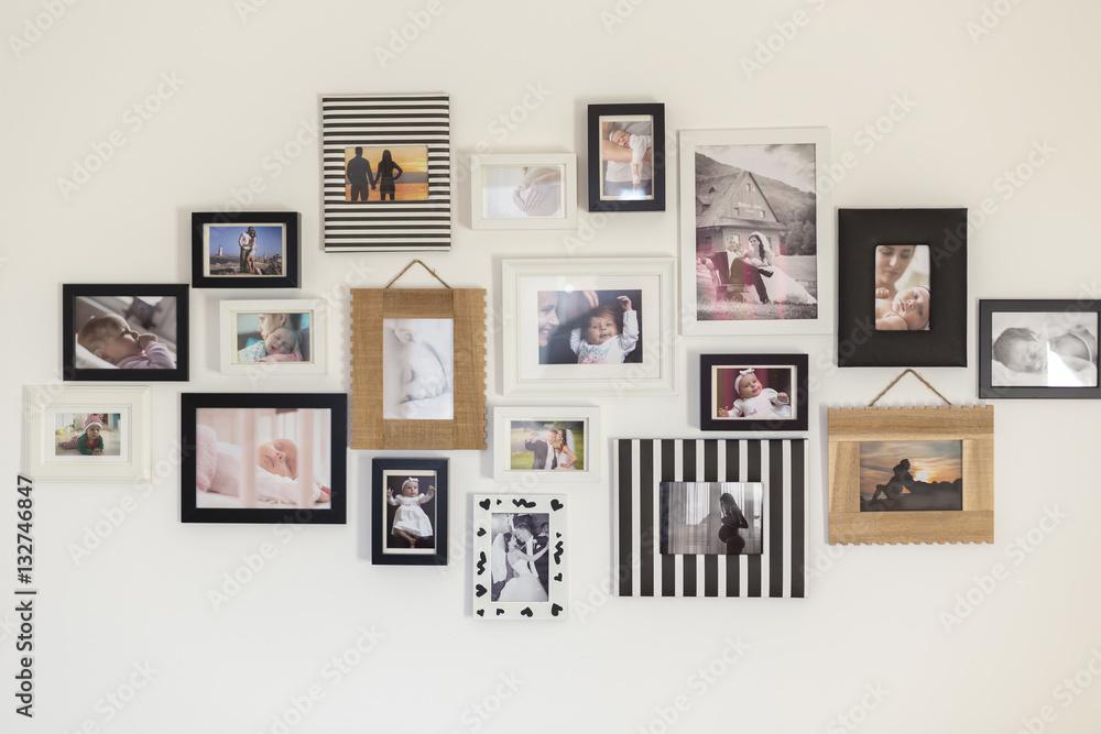 Fototapeta photos of the family in various photo frames - obraz na płótnie