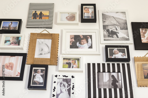 Fototapeta photos of the family in various photo frames obraz na płótnie