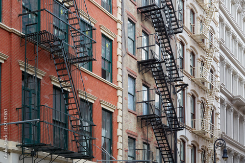 Keuken foto achterwand New York New York buildings with fire escape stairs, sunny day