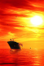 Silhouette Of The Tanker Ship On Red Sunrise.