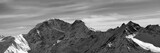 Black and white panorama on winter snow mountains - 132755447