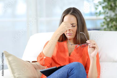Valokuvatapetti Woman with glasses suffering eyestrain