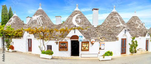 Streets of Alberobello town with Trulli houses in Apulia, Italy Wallpaper Mural