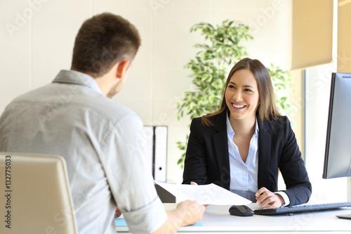 Obraz Man giving curriculum in a job interview - fototapety do salonu