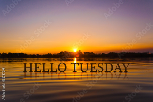 Fotobehang Inspirerende boodschap 'HELLO TUESDAY ' with sunset water , twilight time