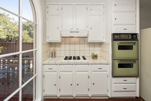Baby Boomer Kitchen With White Tiles And Oven