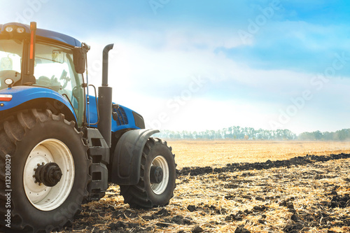 Modern tractor working in a field.