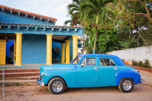 Vászonkép  Blue old classic american car in Vinales, Cuba