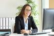 Leinwandbild Motiv Businesswoman with glasses posing at office
