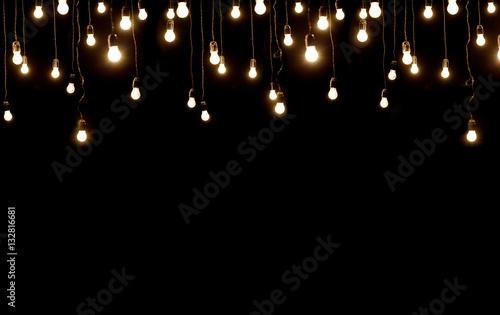 Photo  Light bulbs over dark texture