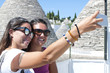 Young women taking selfie on vacation, Puglia, Italy
