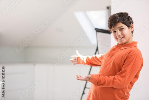 Fotografía  Cute school kid posing in studio with different facial expressio