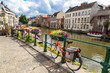 canvas print picture - Bicycles parked by the canal in Gent