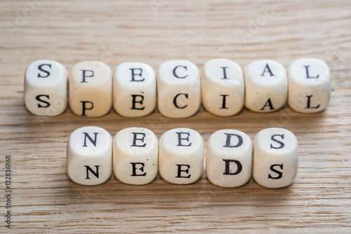 Fotografie, Obraz  Special needs text on a wooden cubes on a wooden background