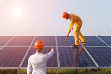 Under The Sun, There Are Two Engineers Checking Solar Cells..Solar Cells Have Been Maintained And Maintenance By A Team Of Engineers.